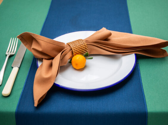 Cinnamon napkin on Oxford Blue table runner table cloth