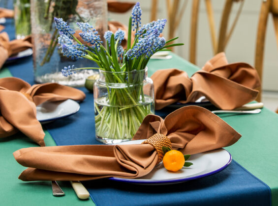 Cinnamon napkin with Oxford Blue table runner on Forest Green table cloth
