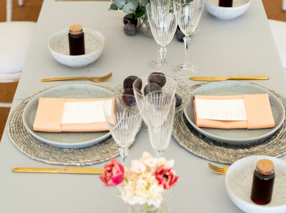 Coral napkins with Pebble Grey table cloths
