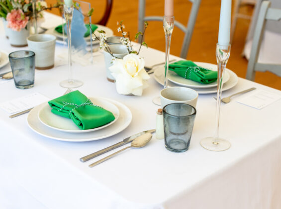 Two Mint Green napkin on Arctic White table cloth