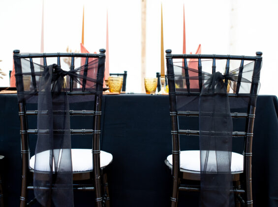 Jet Black organza sashes with Jet Black table cloths and Autumn Orange Napkins