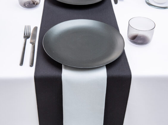 Pebble Grey napkin with Jet Black table runners and Arctic White table cloths