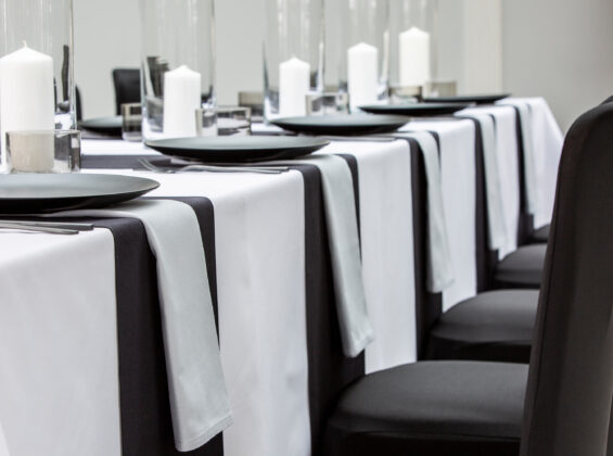 Pebble Grey napkins with Jet Black table runners and Arctic White table cloths