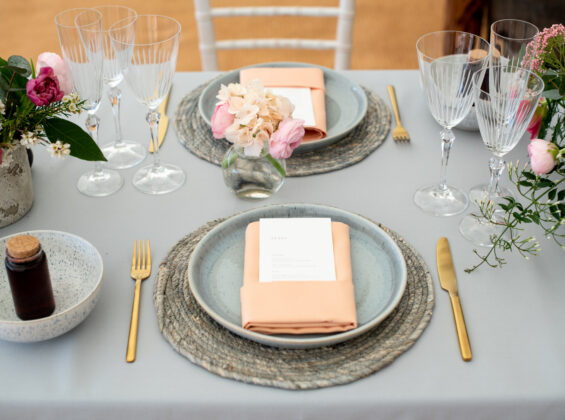 Pebble Grey table cloths with Coral napkins