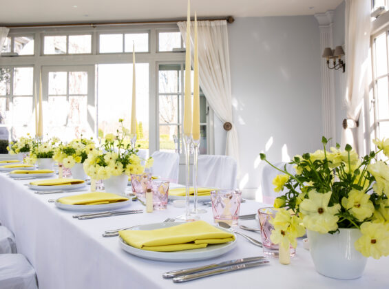 Sicilian Lemon napkins with Arctic White table cloths and chair covers