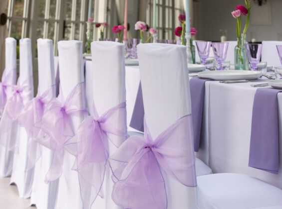 Summer Lavender napkins and organza sashes with Arctic White stretch chair covers and table cloths