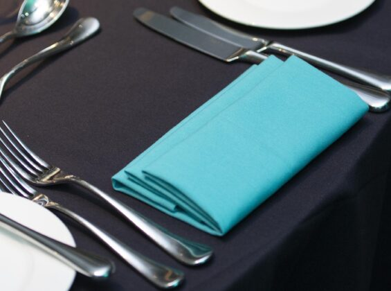 Turquoise Sea napkin on a Jet Black table cloth