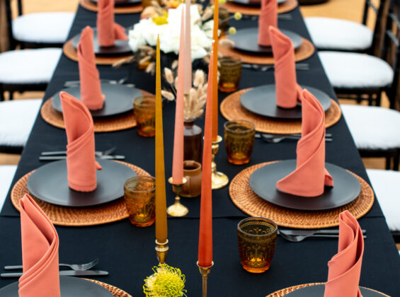 Twelve Autumn Orange napkins on a Jet Black table cloth base