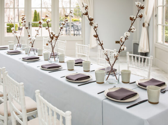 Twelve place settings of Wild Truffle napkins